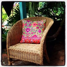 Cane chairs mixed with colourful cushions - perfect mix