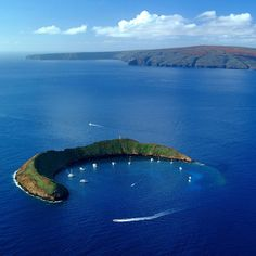 Molokini, off Maui, with Kahoolawe behind it.  snorkled there.  Fun memories with my family, snorkeling here.  Ahhhh.....