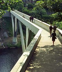 Kingsgate Footbridge - Durham, England; the span is 350 feet long; the photo shows the bridge viewed from one end, showing main span and river below; completed in 1963; designed by Ove Arup