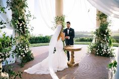 High school sweethearts wed at the luxurious Resort at Pelican Hill with an Italian countryside inspired design. Images by Jamie B Photography. Lighting by Elevated Pulse. http://elevatedpulsepro.com/blog/2017/01/luxury-wedding-resort-pelican-hill/  #weddingdecor #whiteweddingflowers #candlelightwedding #pelicanhill #luxurywedding #weddingtables #receptiondecor #weddingdetails #weddinglighting