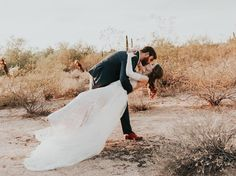 146 Likes, 9 Comments - Megan Henry (@meganhenryphoto) on Instagram bride and groom kissing after ceremony during wedding photos in the desert at sunset