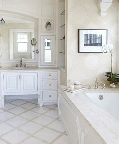 built by Sound Beach Partners of Stamford, Connecticut.  Lovely trellis tile pattern on the floor is subtlety repeated in the wallpaper pattern.