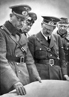 Hitler in Poland by Heinrich Hoffmann -- The Fuhrer and Supreme Commander of the Armed Forces discusses flow of the battle with Colonel General List. Wilhelm Keitel and Alfred Jodl can be seen behind Hitler.
