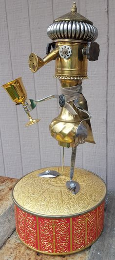 King Artie rules his kingdom with an iron fist.well, it may just be sterling silver or brushed aluminum. You be the judge. He is actually a pretty kewl Alice In Wonderland Steampunk, Metal Robot, Metal Watering Can, Little King, Castle Wall, Found Object Art, Junk Art, Robot Art, Assemblage Art