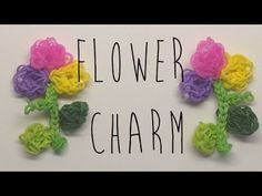 Rainbow Loom FLOWER Charm with stem and leaves. Designed and loomed by Mario at OfficiallyLoomed. Click photo for YouTube tutorial. 05/07/14.