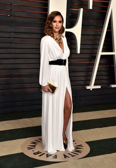 Wearing a Roberto Cavalli gown, David Webb jewelry, and Brian Atwood heels. Image Source: Getty / Alberto E...