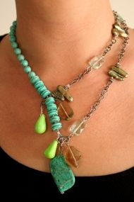 """Asymmetrical turquoise necklace    3-strand 12 1/2"""" long asymmetrical necklace with turquoise, lemon quartz, freshwater pearl, Czech. glass and antiqued sterling silver chain.  The necklace features 5 drop dangles in different green tones that attractively hang in the decollete.    This is a limited edition, one-of-a-kind item.  Price: $189.00"""