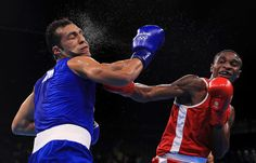 Merven Clair of Mauritius (red) fights against Hosam Hussein Bakr Abdin of Egypt (blue) in their Men's Middleweight 75kg bout on Day 4 of the Rio 2016 Olympic Games at the Riocentro - Pavilion 6 on Aug. 9, 2016. | Best Photos From The Rio Olympics