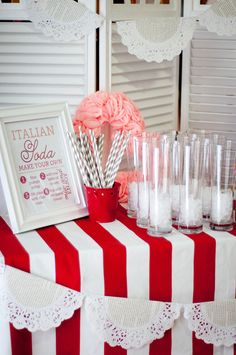 italian soda bar; intruction board, paper straws, flavored syrups, cream, sparkling water, tall glasses, and pebble ice