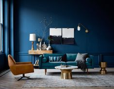 Sophisticated living room with dark blue walls and metallic finishes | NONAGON.style