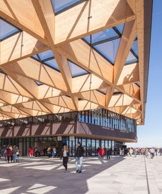 mecanoo designs gatehouse topped with a timber canopy for keukenhof flower garden