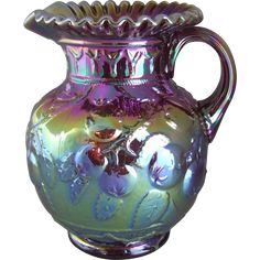 "Fenton ruby red iridescent glass carnival glass pitcher in the Apple Tree pattern 6555 RN.   Measures approximately 9"" tall.  Excellent condition"