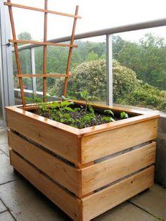 raised garden box #porch or #balcony also. Wood box to hide plastic tub inside!