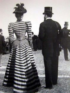 Actual Victorian, real tiny waist, top hats everywhere, and what a coat!