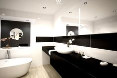 Schwarz und weiß dominieren dieses Badezimmer durch und durch
