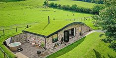 Nestled in the heart of the Welsh countryside this cosy retreat with a real grass roof is perfect for families looking for a fun staycation idea this year. The Burrow, Earth Homes, Staycation, Architecture, Wales, Countryside, Exterior, House Design, House Styles