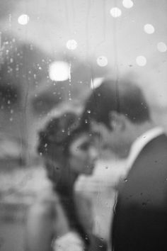 Rainy days get make for such romantic wedding photos. Photo by Sarah C. Photography.   http://www.thebridelink.com/blog/2013/01/02/top-25-photos-of-2012/#