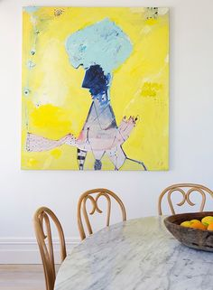 An abstract painting in a timeless and traditional dining area
