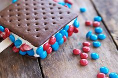 I love ice cream sandwiches, so I added some m&m's to make them perfect for the of July. I just bought a bag of m&m minis and separated the blues and reds. I added a craft stick to each of the ice cream sandwiches and then pressed on some m&m's. 4th Of July Celebration, 4th Of July Party, Fourth Of July, Blue Desserts, Easy No Bake Desserts, Patriotic Desserts, Oreo Cookie Cake, Cookie Bars, Yummy Treats