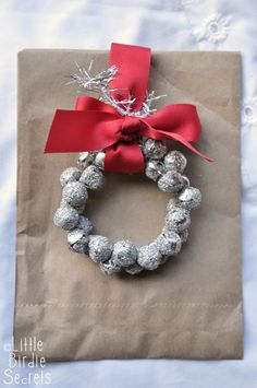 Little Birdie Secrets: glass glitter jingle bell wreath tutorial