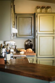 Take a peek in my kitchen! | The Elliott Homestead Wooden countertops and milk paint recipe for redoing cabinets