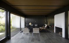 Halldor Gunnløgssons house, Denmark - softwood timber paneled walls painted in a dark colour to bring richness