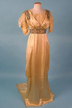 Yellow satin evening gown with beaded panels and lace bodice and sleeve overlay, 1912-14.