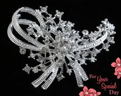 This bridal brooch truly sparkles and shines! A floral burst with ribbon that looks delicate and beautiful. Made of grade A+ crystal rhinestones that catch the light at every angle. Would be perfect on a bouquet or dress. by ForYourSpecialDay, $25.99