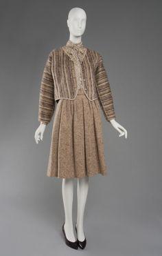 Geoffrey Beene Jacket: striped mohair wool; Skirt: heathered tan wool; Blouse and Tie: beige printed silk plain weave