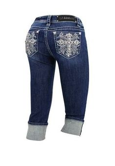LA Idol® cross back pocket denim caprisCROSS BACK POCKET MEDIUM WASH CAPRIS LA Idol® cross back pocket denim capris. Heavy stitching and crystal rivets throughout. Five-pocket styling with large embroidered cross on back pockets. Zip fly. Domestic cotton/elastin. Sizes 0-13. Medium denim. 6286Orig $56.00 Now $29.99