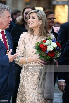Munich mayor Dieter Reiter and Queen Maxima of the Netherlands talk as they cross Marienplatz on April 13, 2016 in Munich, Germany. King Willem-Alexander and Queen Maxima are on a two-day visit in Bavaria to strengthen the relationship between Bavaria and the Netherlands.