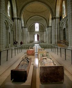 (Rear) Tombs of Henry II and Eleanor of Aquitaine.  (Front) Tombs of Isabella Taillefer and Richard the Lionheart.  Fontevraud Abbey, France.