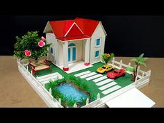 DIY How to make a Wonderful house with Hot glue mini Pond. DIY How to make a Wonderful house with … Popsicle Stick Houses, Popsicle Stick Crafts, Craft Stick Crafts, Diy Crafts For Kids, Home Crafts, Fun Crafts, Cardboard Houses For Kids, Diy Cardboard, Paper Houses