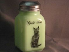 Green Milk Glass Garlic Salt Spice Shaker with Caz the Cat Logo by Mossopeddler. $17.99. Fired On Decals for Long Lasting. Timeless Sitting Cat Theme. Very charming cottage theme. American Made Glassware. Great mixing bowls. See our entire line of Jade green milk glass, Jadeite, hand made in America. This is a must for the cat lovers in all of us.   Be sure to collect the entire set. We call this our Cazzabella line.  Named for our wonderful russian blue looking cat.  Purchas...