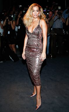Rita Ora from Sequined Dresses for Every Holiday Party  Now is your time to shine bright like a diamond! Need to update your holiday dress wardrobe? We've got you covered! Rose gold has become a staple metallic, adding radiance to any skin tone. The singer stunned with this shimmering body-con dress at Tom Ford's cocktail party in NYC. Shine bright by adding pink-toned accessories.