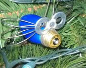 Blue Christmas Bug Ornament.  Use a large Christmas light bulb, 9 gauge wire, 2 small washers and JB Weld glue..