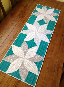 Love this pattern and the quilting on this table runner is amazing! The pattern is free.