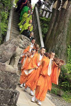 a procession of Buddhist priests, Mt. Takao, Japan
