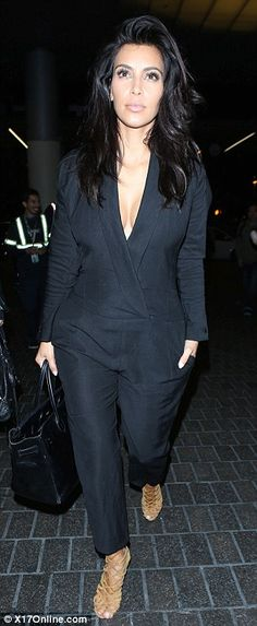 Singular style: The 34-year-old wore a chic jumpsuit with Hermes heels for her flight to Australia