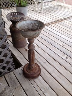 Planter made of an old table leg, an old colander, and a brake drum from an old car! I love this.