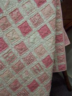 pink vintage baby quilt.