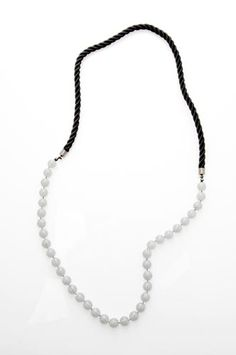 Barcelona black cord and glass necklace in white, grey, purple, and blue ($45)