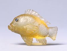 Goldfish, late 1800s-early 1900s firm of Peter Carl Fabergé (Russian, 1846-1920) topaz, rose-cut diamond eyes set in gold,  (h:1 w:1 5/16 d:5/8 inches).