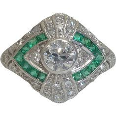 Beacon Hill Jewelers Presents: A stunning dramatic art deco period diamond and French cut emerald ring in 14 karat white gold.  Set with a total of