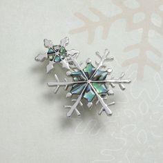 Natural Paua shell snowflake brooch.