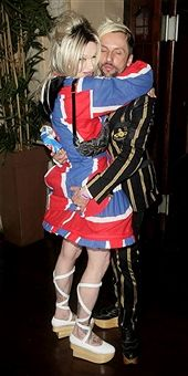 Singer Pete Burns (L) and his guest arrive at a private gig to be perfomed by Prince at Koko on May 10, 2007 in London, England. The pop superstar is due to play '21 Nights in London' in the capital later this summer, starting on August 1 at the O2 Arena.