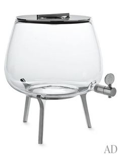 Christofle's Silver Time tea fountain, made of glass and silver-plated stainless steel. The beverage server can hold both hot and cold drinks.