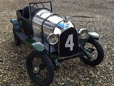 Bentley Pedal car based on the 1930's 3ltr Le Mans car with number 4 to grill, finished in green with a polished aluminium bonnet and polished radiator shell
