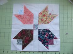 """This free quilt pattern is the """"Scrappy Calico Tulip Quilt Block""""."""