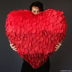 Learn how to make your own heart shaped piñata at any size! Use them for weddings, Valentine's Day celebrations, bridal showers and more